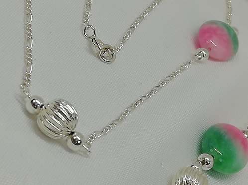 Pretty cherry jade ovals are enhanced with large sterling silver necklace