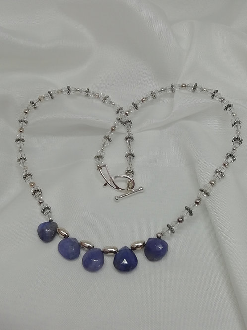 Handmade Faceted and graduated trillian cut tanzanites and sterling silver necklace