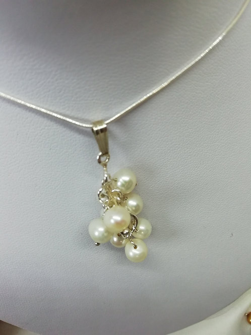 Handmade natural Freshwater pearls set on a sterling silver chain pendant