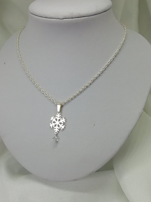 Hnadmade Sterling silver snowflake and crystal accent on a sterling silver necklace