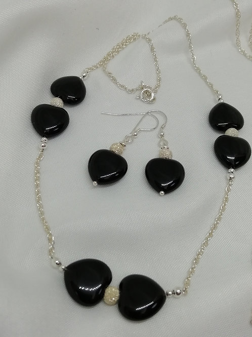 Black agate puffy hearts with sterling silver stardust spacers necklece