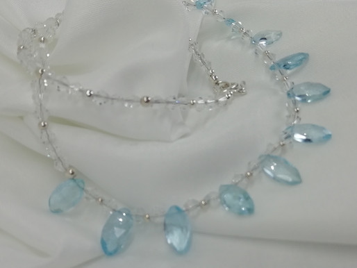 Handmade Faceted marquise cut blue topaz set on a swarovski crystal necklace