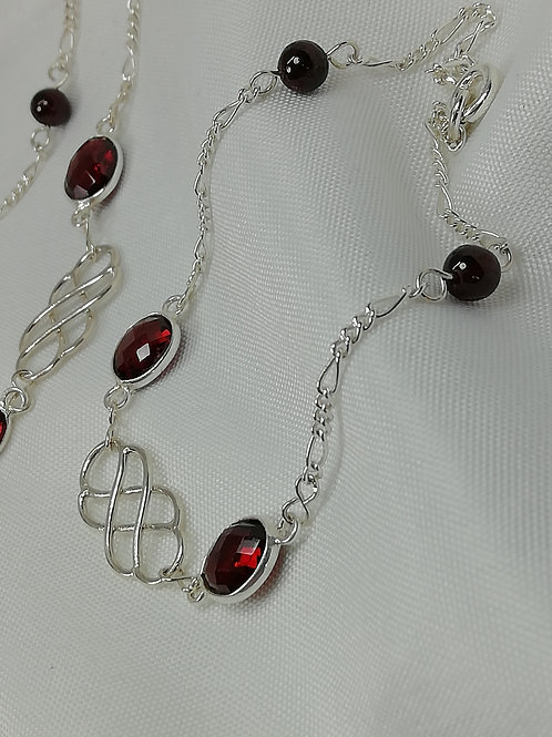 Faceted Oval Garnets set with Silver Celtic Double Bracelet