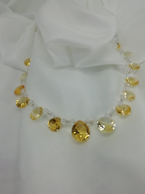 Handmade Faceted pear-cut graduated citrines set on a swarovski crystal necklace