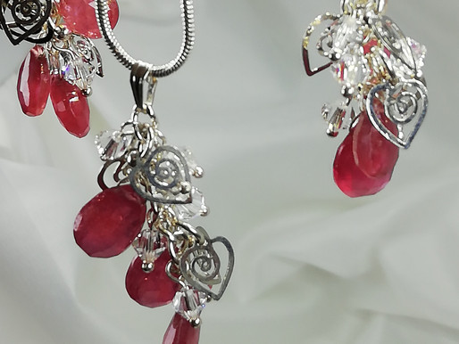 Handmade Faceted pear-shaped rubies with crystals and silver pendant