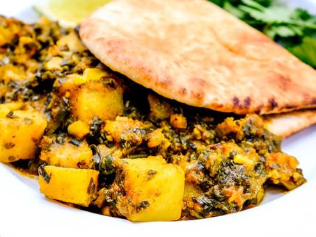Spinazie met aardappelcurry voor Pitta