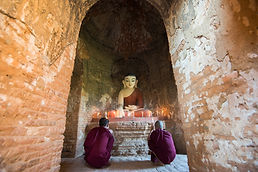 Young Monks Praying in Front of Buddha S