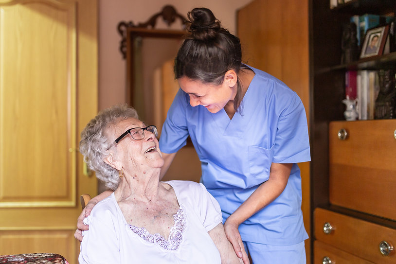 Medical nurse helping elderly woman at patients residence