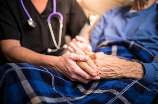 in-home nurse caring for elderly patient