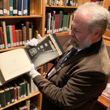 """James Hanks, the DIA's archivist, helps with historical research of """"The Wedding Dance."""" Amazingly, he found a print from 1930, the year the painting was acquired. It shows the work on view in a gilt frame! By 1939, the painting had been changed into its current frame. #WheresTheBruegel #artconservation #archives #frames"""