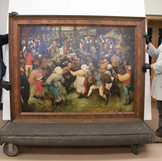 "Did you know? The DIA's ""The Wedding Dance"" by Pieter Bruegel the Elder is one of only a few of his paintings in this country. Coming 2019-2020, the DIA will host an exhibition about this spectacular painting to celebrate its importance and honor the 450th anniversary of the artist's death. In preparation, the DIA's conservation team will be closely studying the paint, technique, and history of the painting in the lab for the next two weeks. Follow our #WheresTheBruegel posts for daily updates while the work is off view through June 19! _______________ As seen in these photos, our Collections Management team safely deinstalled the painting and moved it to the conservation lab earlier today, where Paintings Conservator Ellen Hanspach-Bernal and Graduate Intern Becca Goodman are examining it. #PieterBruegel #PieterBruegeltheElder #Bruegel #artconservation"