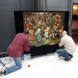 """Every work in the DIA's collection is photographed by our in-house professional photographers. While """"The Wedding Dance"""" by Pieter Bruegel the Elder has been photographed numerous times over the past 89 years, today the painting is with our photographers, Eric Wheeler and James Rotz, who will capture a better quality, high resolution, color accurate image for scholarly and public use. Our photography department generates images representing the collection in the best possible way, effectively a """"glamour shot,"""" while Conservation imaging works to capture the painting's condition. #WheresTheBruegel #artconservation"""