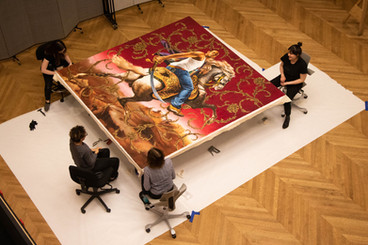 """Kehinde Wiley's """"Officer of the Hussars"""" is back from being on loan! Because of its size, the painting had to be removed from its stretcher and rolled for transit. DIA conservators and museum technicians carefully planned and documented the process (which included dismantling the large artist-made frame!) — upon its return to the DIA, the painting was placed back on its stretcher and into its reassembled frame. This took 8 people and 8 hours to accomplish! Thanks to the dedicated Conservation and Collections Management staff, both painting and frame are back on view — now on display in Kresge Reception S250.  #artconservation#arthandling"""