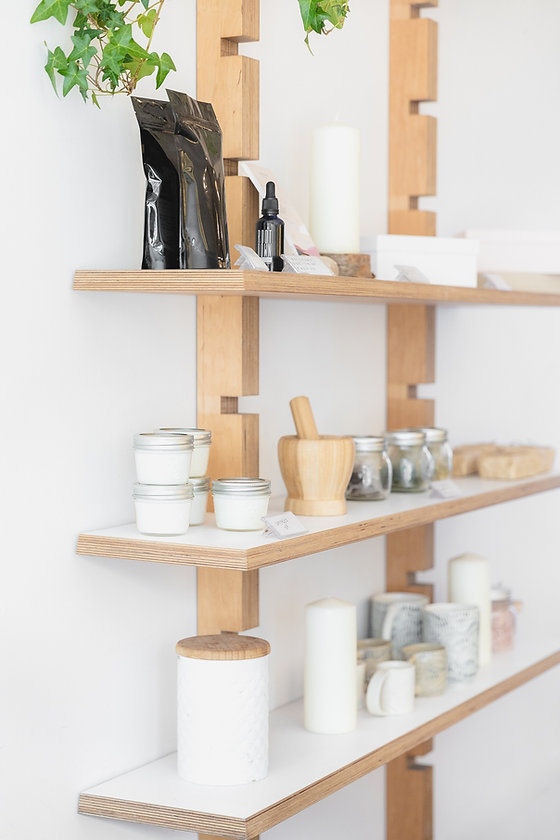 jars-candles-and-ceramics-on-wooden-shel