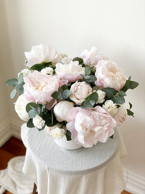 Medium flower arrangement including vase