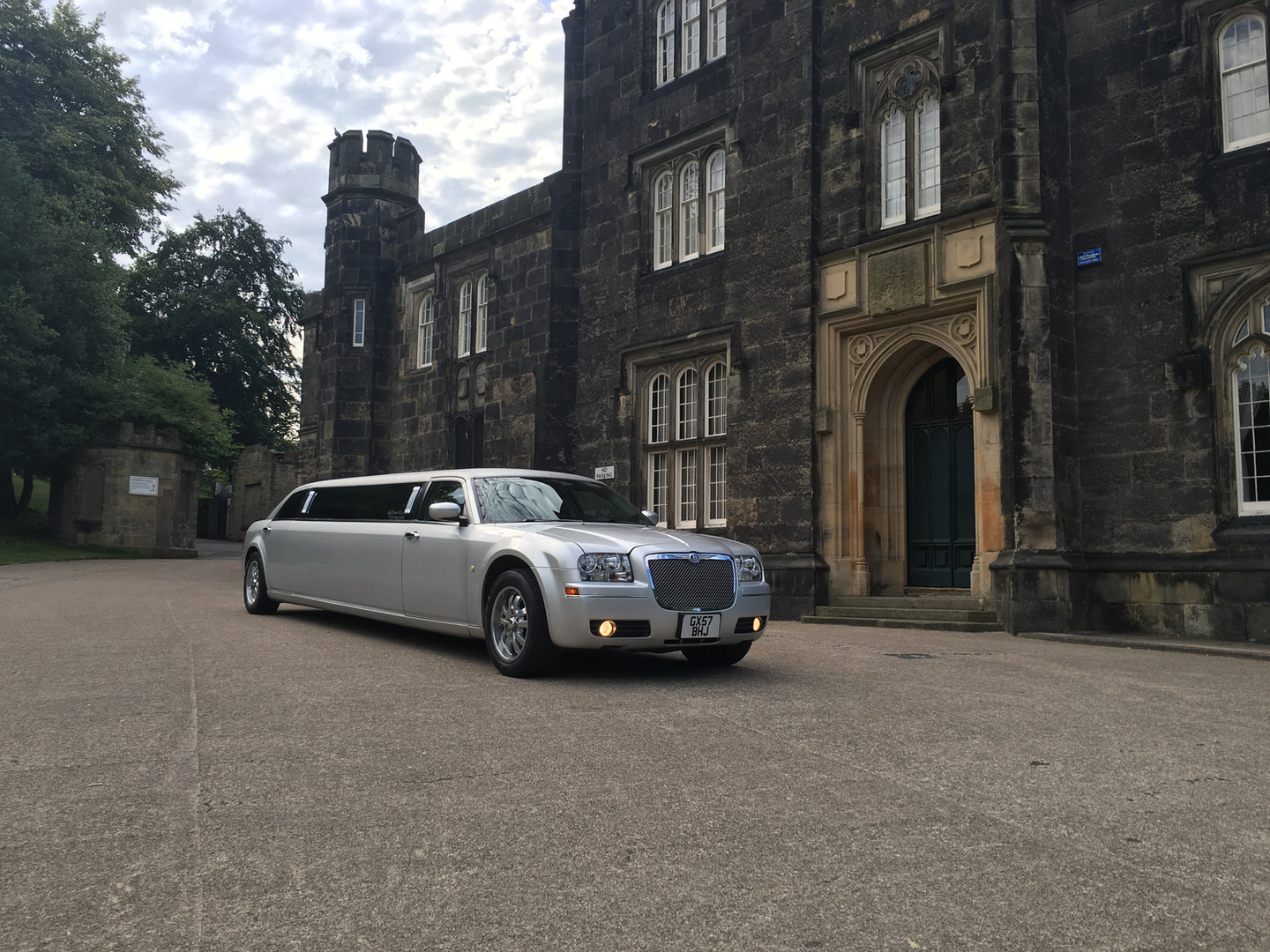 Silver Bentley style limo