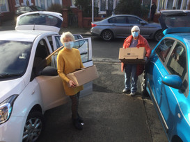 At Blackpool Food Bank filling two cars with food.