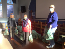 Preparing 50-60 bags with donations for the Food Bank.