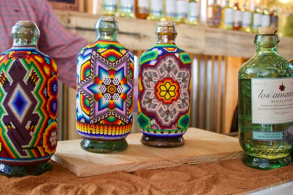 Beautifully hand decorated bottles by Las Amantes