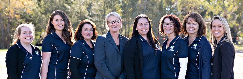 Ready to help: The women of Western NSW Community Legal Centre line up for a group photo.