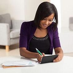 black lady writing a check.jpg