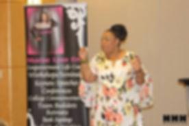 Sharise Speaking in Floral Dress.jpg