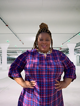 Sharise in Plaid white building.png