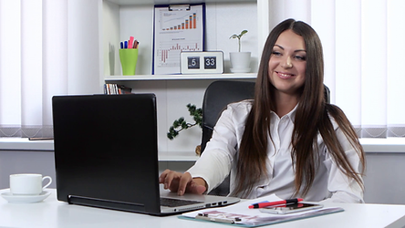 Business Woman in front of laptop.png