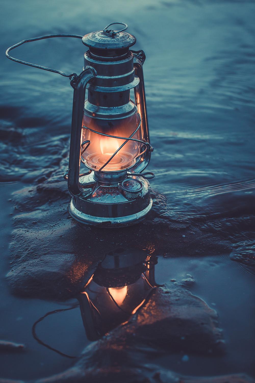 A glowing lantern in the tide.