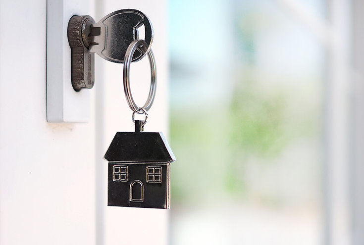house-key-unlocking-new-house-is-plugged