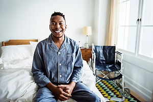 A smiling man in bed.jpg