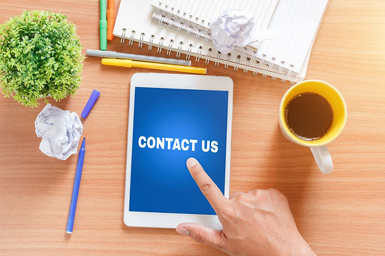Contact US concept. Tablet with text ins