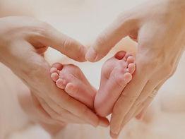 baby-feet-in-mother-hands-tiny-newborn-b
