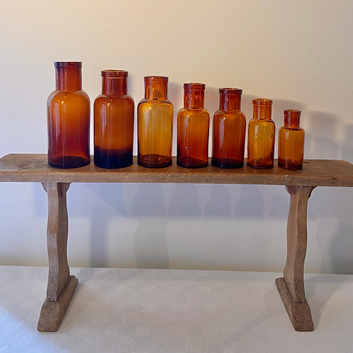 7 amber glass vintage apothecary bottles