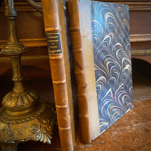 Pair of leather and marbled bound antique French books