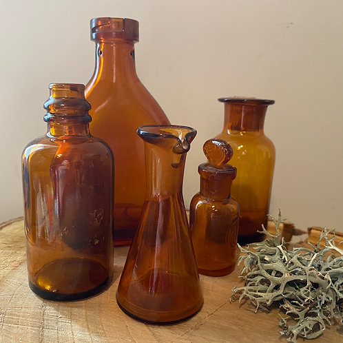 Display collection apothecary amber glass French bottles