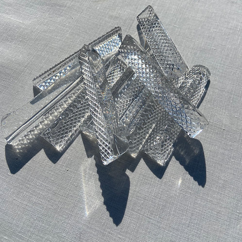 10 glistening cut crystal knife rests.