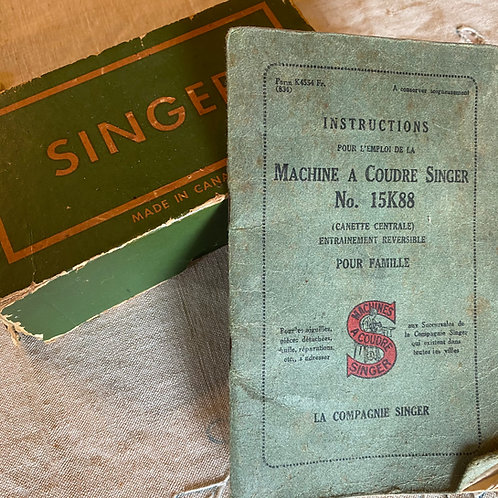 Vintage Singer sewing machine box of accessories and French instructions