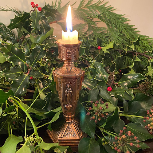 Religious candlestick with image of Mary