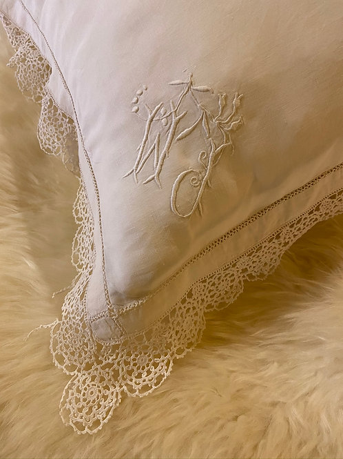 Delicate trousseau lace edged monogrammed French pillowcase.