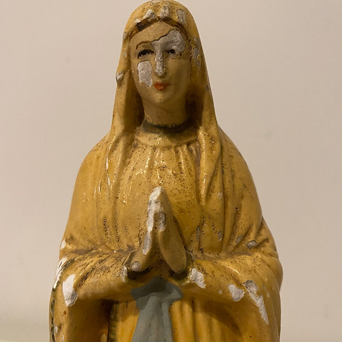 Vintage timeworn statue of the Virgin Mary