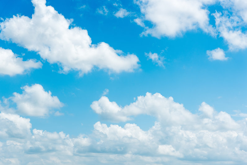 clear blue sky with plain white cloud wi
