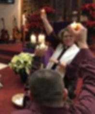 Members raise candles