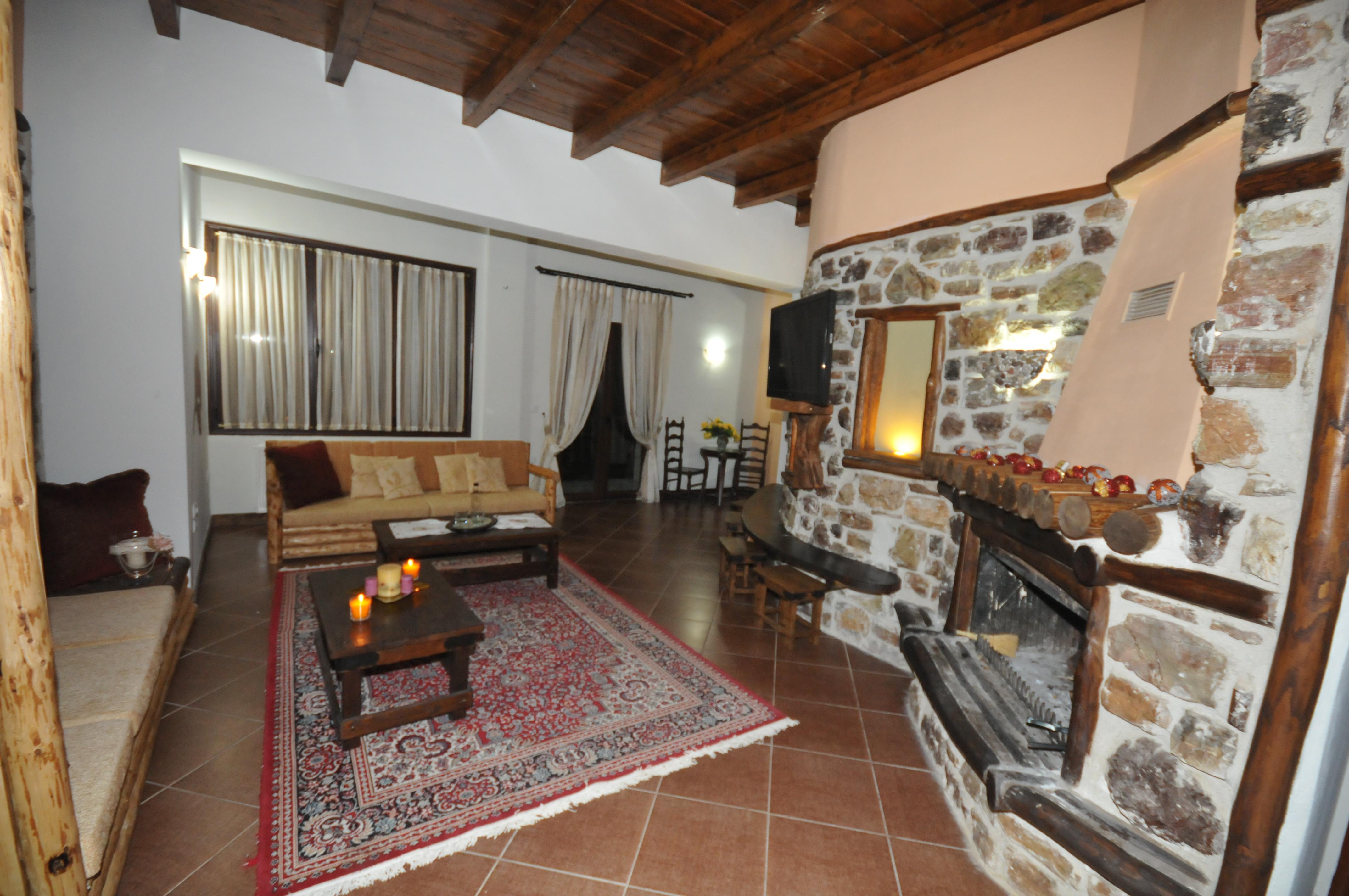 Σαλόνι ξενώνα με αναπαυτικά καθίσματ