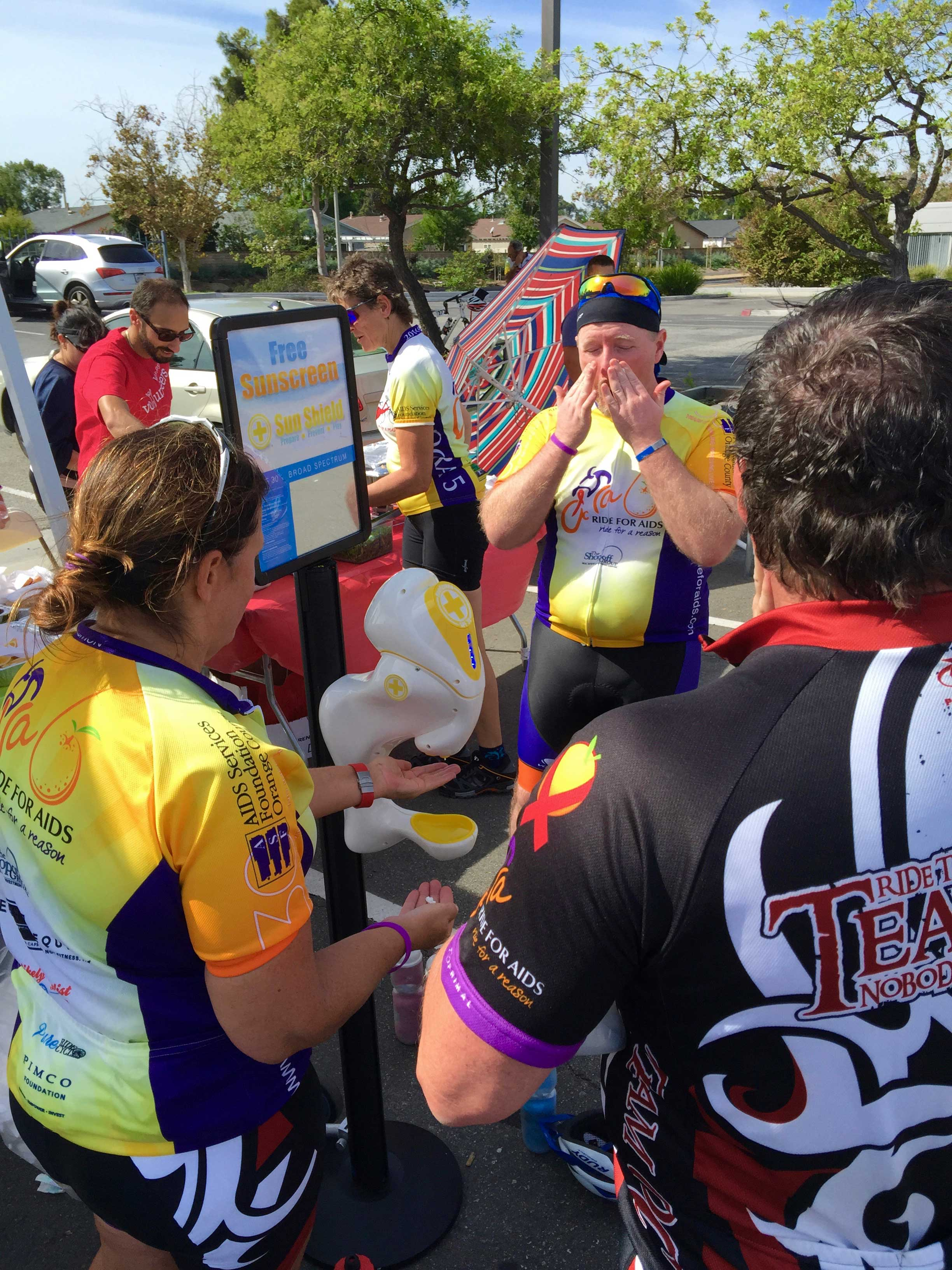Orange-County-Ride-For-Aids-Los-Angeles-Sunscreen-skin-cancer-melanoma-dispenser-sun-shield-sunblock