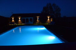 Night time views of The Pool House