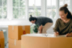 happy-young-couple-among-boxes-at-new-ho