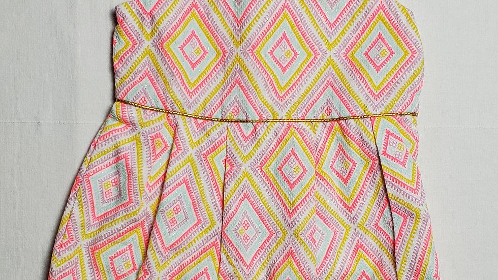 vestidofiguras de colores rosas, azules, amarillos y morados