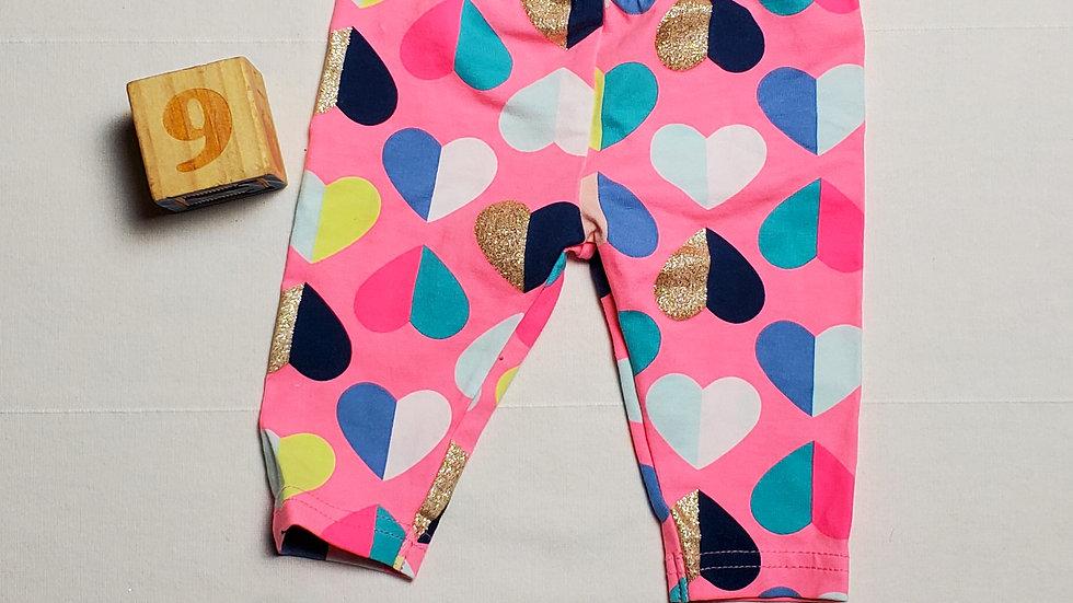 leggins rosa con corazones de colores