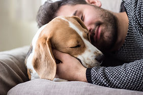 Young man sleeping with a dog_